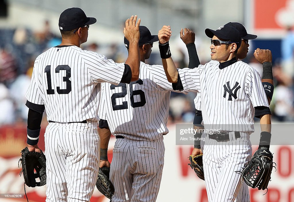 <a gi-track='captionPersonalityLinkClicked' href=/galleries/search?phrase=Ichiro+Suzuki&family=editorial&specificpeople=201556 ng-click='$event.stopPropagation()'>Ichiro Suzuki</a> #31 of the New York Yankees shakes hands with teammates after defeating the Tampa Bay Rays at Yankee Stadium on September 16, 2012 in the Bronx borough of New York City.