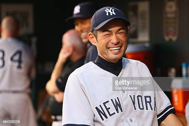 Ichiro Suzuki of the New York Yankees shares a laugh with teammates int he dugout in the second inning against the St Louis Cardinals at Busch...