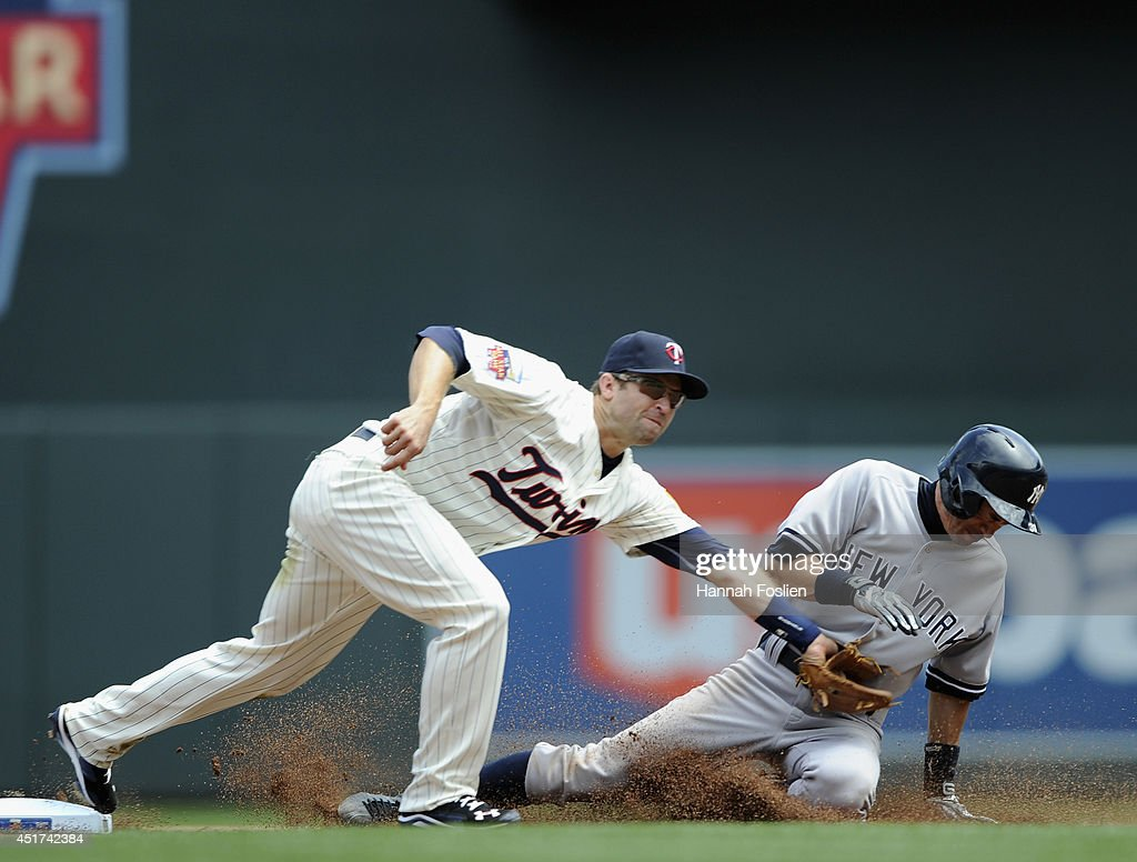 Ichiro Suzuki #31 of the New York Yankees steals second base as Brian Dozier #2 of the Minnesota Twins fields the ball during the fifth inning of the game on July 5, 2014 at Target Field in Minneapolis, Minnesota. The Twins defeated the Yankees 2-1 in eleven innings.