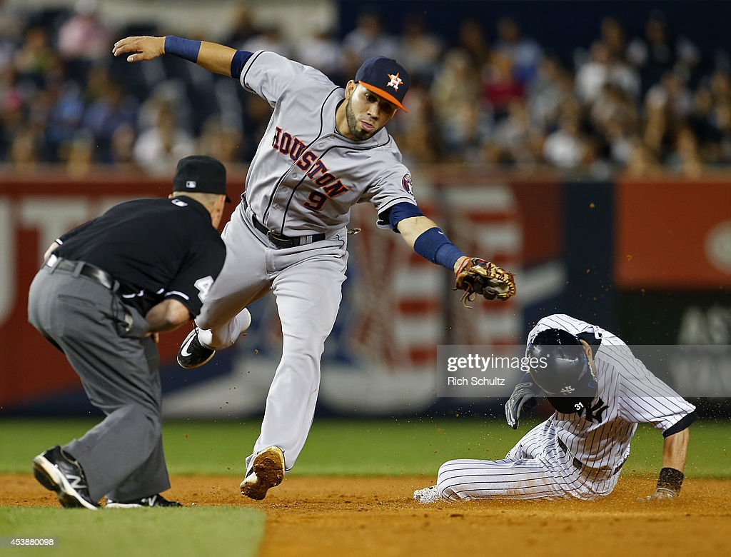 <a gi-track='captionPersonalityLinkClicked' href=/galleries/search?phrase=Ichiro+Suzuki&family=editorial&specificpeople=201556 ng-click='$event.stopPropagation()'>Ichiro Suzuki</a> #31 of the New York Yankees steals second base before shortstop Marwin Gonzalez #9 of the Houston Astros can make the tag during the fifth inning of a MLB baseball game at Yankee Stadium on August 20, 2014 in the Bronx borough of New York City.