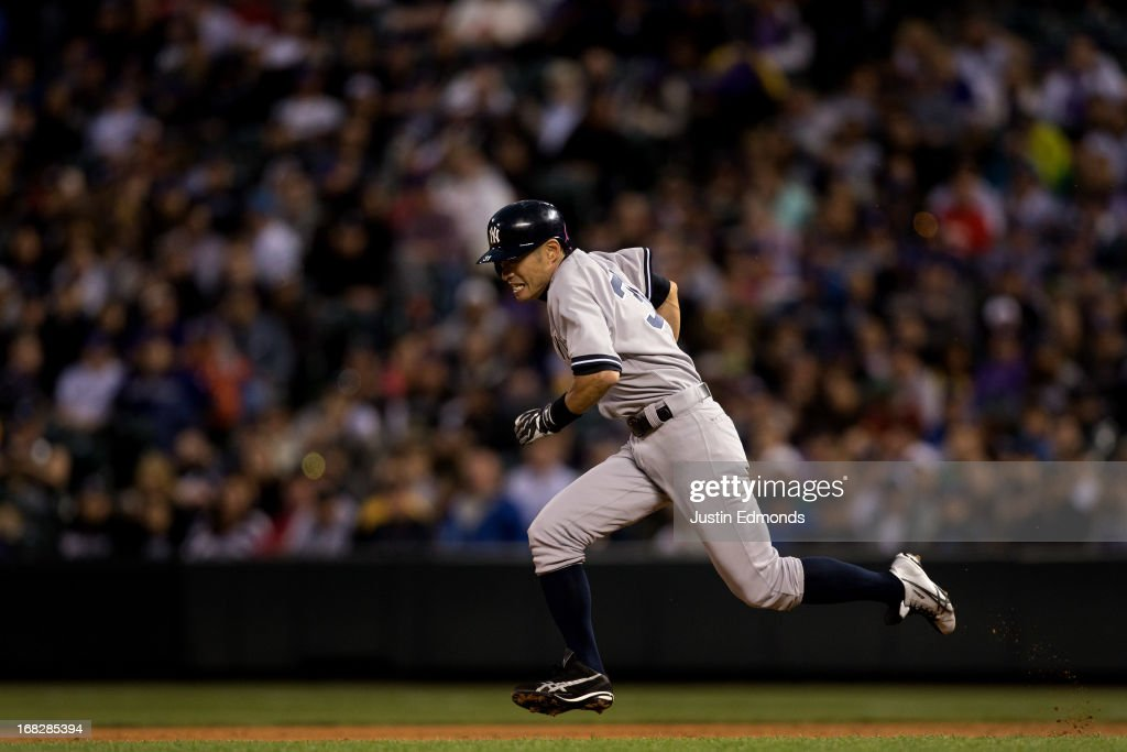 <a gi-track='captionPersonalityLinkClicked' href=/galleries/search?phrase=Ichiro+Suzuki&family=editorial&specificpeople=201556 ng-click='$event.stopPropagation()'>Ichiro Suzuki</a> #31 of the New York Yankees steals second base during the third inning against the Colorado Rockies at Coors Field on May 7, 2013 in Denver, Colorado.