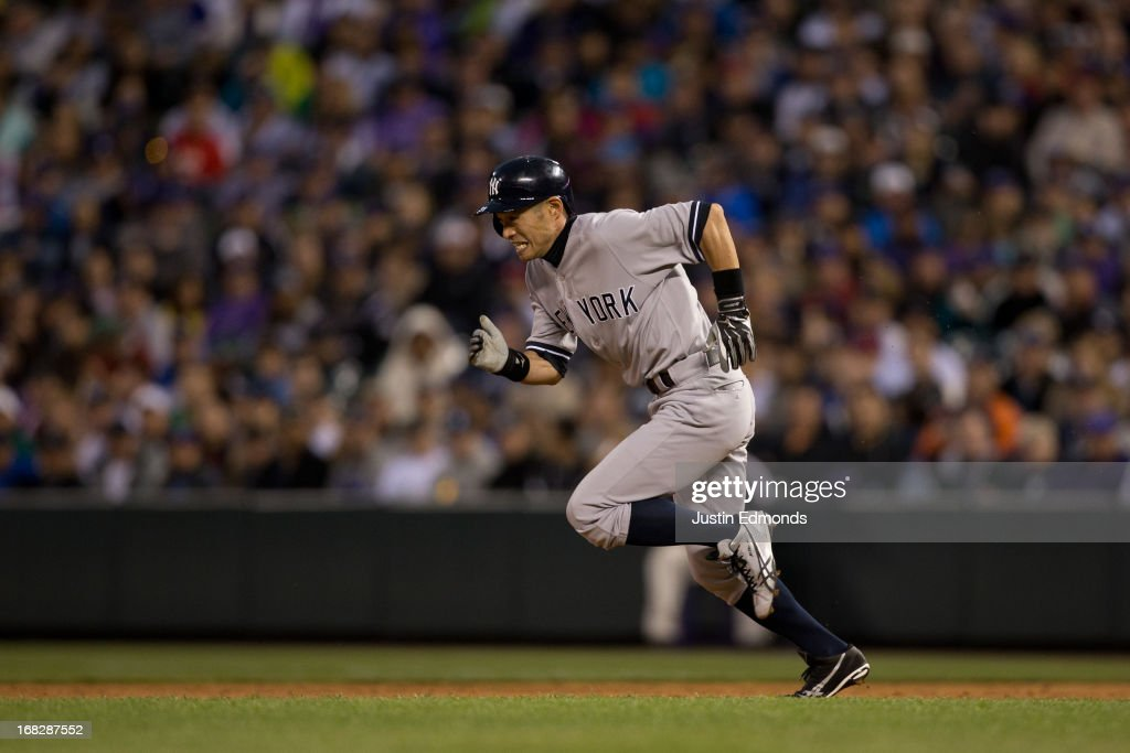 Ichiro Suzuki #31 of the New York Yankees steals second base during the third inning against the Colorado Rockies at Coors Field on MAY 7, 2013 in Denver, Colorado.