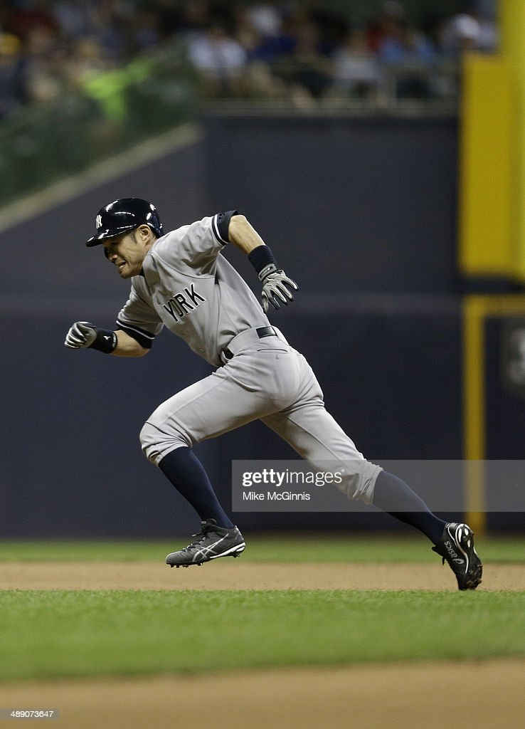 <a gi-track='captionPersonalityLinkClicked' href=/galleries/search?phrase=Ichiro+Suzuki&family=editorial&specificpeople=201556 ng-click='$event.stopPropagation()'>Ichiro Suzuki</a> #31 of the New York Yankees steals third base in the top of the eighth inning against the Milwaukee Brewers during the Interleague game at Miller Park on May 09, 2014 in Milwaukee, Wisconsin.