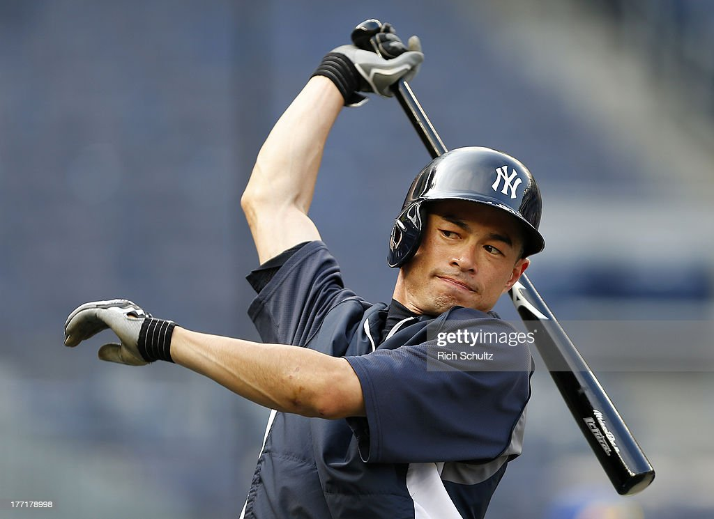 Ichiro Suzuki #31 of the New York Yankees stretches before batting practice prior to the start of a game against the Toronto Blue Jays at Yankee Stadium on August 21, 2013 in the Bronx borough of New York City.