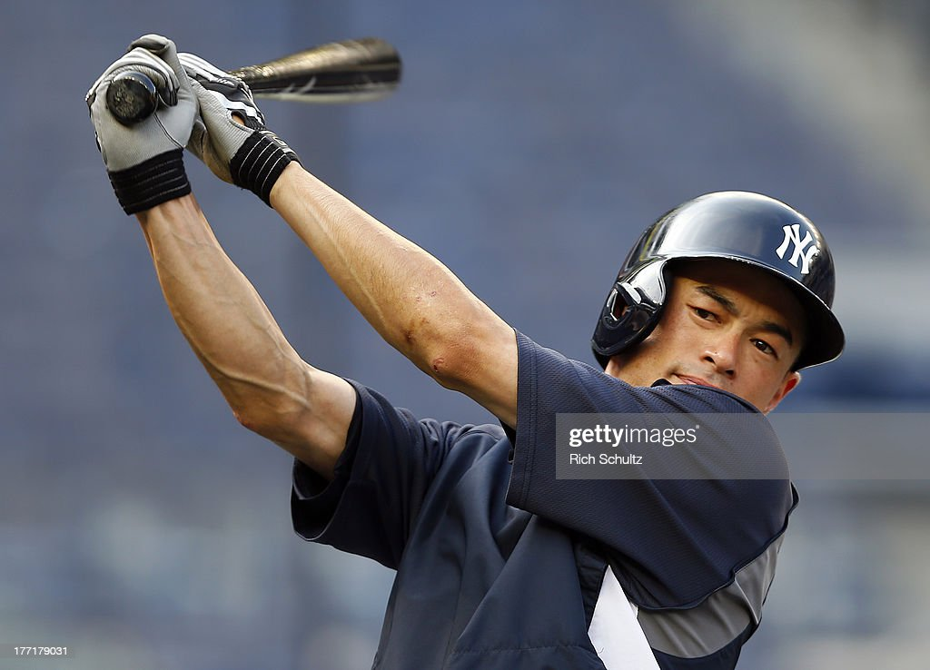 Ichiro Suzuki #31 of the New York Yankees stretches during batting practice prior to the start of a game against the Toronto Blue Jays at Yankee Stadium on August 21, 2013 in the Bronx borough of New York City.