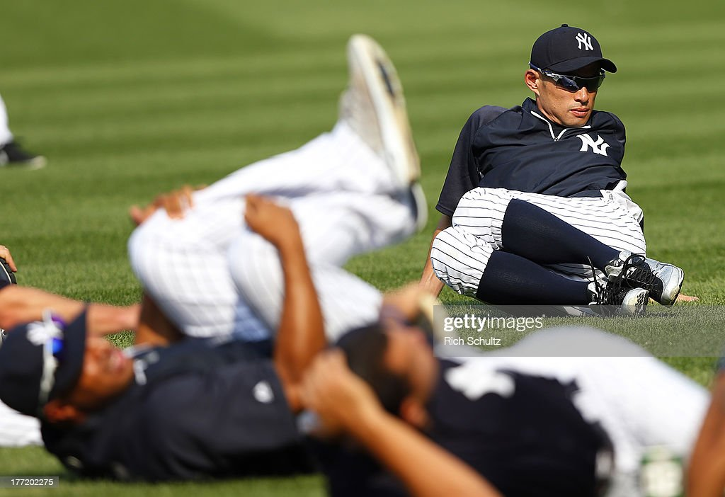Ichiro Suzuki #31 of the New York Yankees stretches prior to the start of a game against the Toronto Blue Jays at Yankee Stadium on August 121, 2013 in the Bronx borough of New York City.