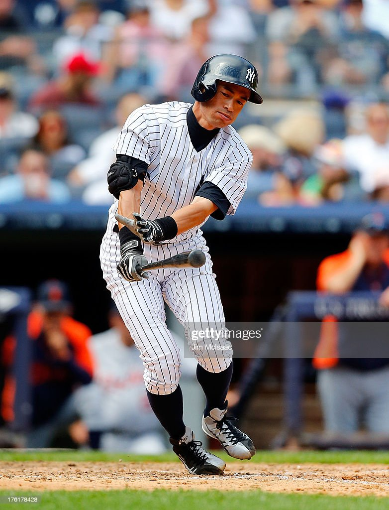 <a gi-track='captionPersonalityLinkClicked' href=/galleries/search?phrase=Ichiro+Suzuki&family=editorial&specificpeople=201556 ng-click='$event.stopPropagation()'>Ichiro Suzuki</a> #31 of the New York Yankees strikes out in the fifth inning against the Detroit Tigers at Yankee Stadium on August 11, 2013 in the Bronx borough of New York City. The Yankees defeated the Tigers 5-4.