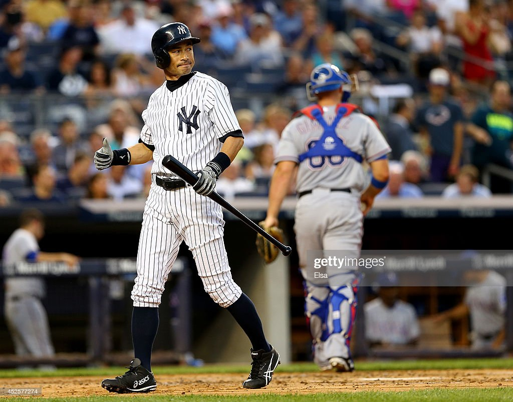 <a gi-track='captionPersonalityLinkClicked' href=/galleries/search?phrase=Ichiro+Suzuki&family=editorial&specificpeople=201556 ng-click='$event.stopPropagation()'>Ichiro Suzuki</a> #31 of the New York Yankees strikes out to end the second inning as <a gi-track='captionPersonalityLinkClicked' href=/galleries/search?phrase=Chris+Gimenez&family=editorial&specificpeople=4959066 ng-click='$event.stopPropagation()'>Chris Gimenez</a> #60 of the Texas Rangers heads for the dugout on July 23, 2014 at Yankee Stadium in the Bronx borough of New York City.