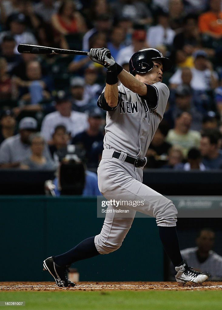 Ichiro Suzuki #31 of the New York Yankees swings at a pitch in the fifth inning against the Houston Astros at Minute Maid Park on September 28, 2013 in Houston, Texas.