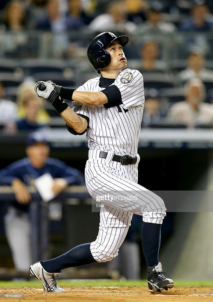 Ichiro Suzuki #31 of the New York Yankees takes a swing in the first inning against the Tampa Bay Rays on September 26, 2013 at Yankee Stadium in the Bronx borough of New York City.