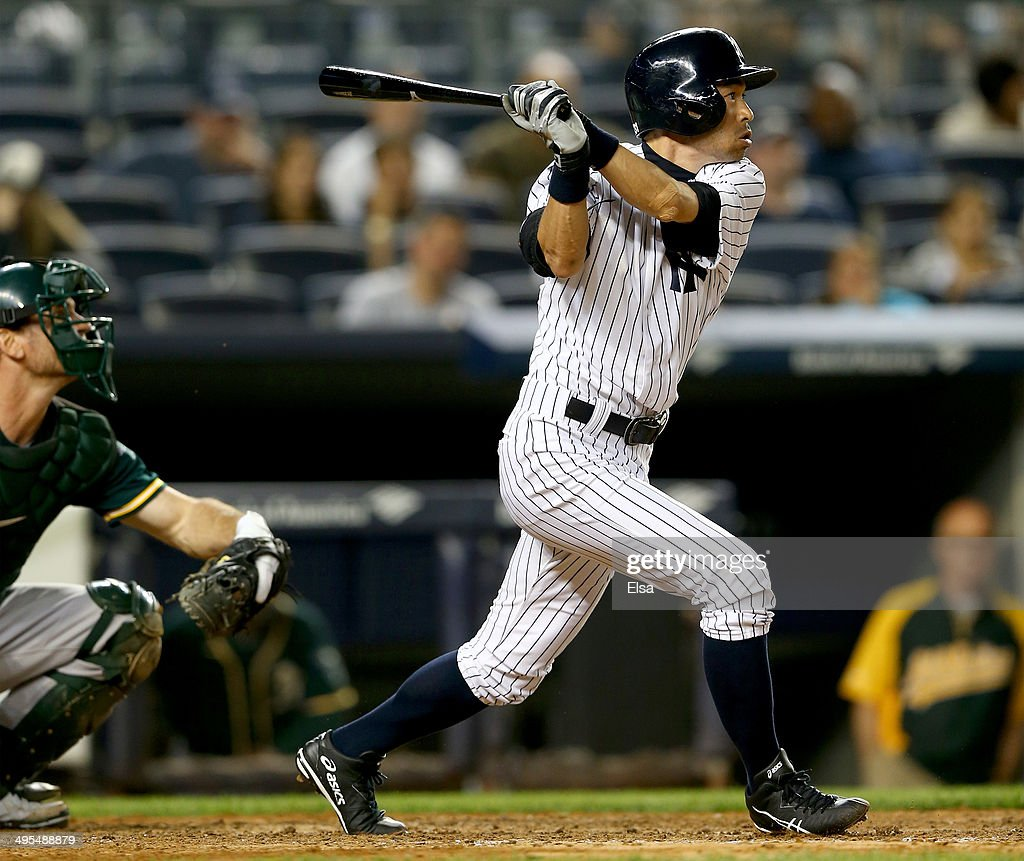 Ichiro Suzuki #31 of the New York Yankees takes his turn at bat in the eighth inning as John Jaso #5 of the Oakland Athletics defends on June 3, 2014 at Yankee Stadium in the Bronx borough of New York City.