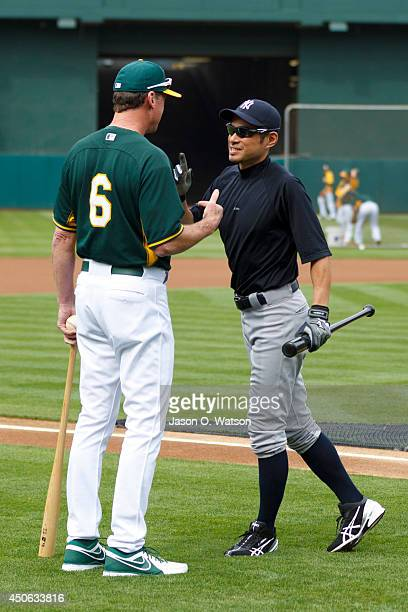 Ichiro Suzuki of the New York Yankees talks to Bob Melvin of the Oakland Athletics during batting practice before the game at Oco Coliseum on June 14...