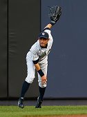 Ichiro Suzuki of the New York Yankees throws the ball into second base on a double by Victor Martinez of the Detroit Tigers in the second inning at...