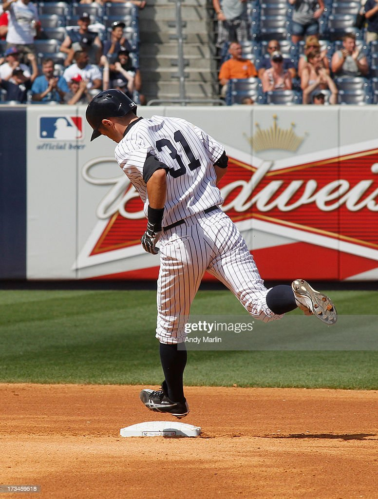 <a gi-track='captionPersonalityLinkClicked' href=/galleries/search?phrase=Ichiro+Suzuki&family=editorial&specificpeople=201556 ng-click='$event.stopPropagation()'>Ichiro Suzuki</a> #31 of the New York Yankees touches second base after hitting a solo home run in the bottom of the seventh inning against the Minnesota Twins at Yankee Stadium on July 14, 2013 in the Bronx borough of New York City. The Twins defeated the Yankees 10-4.