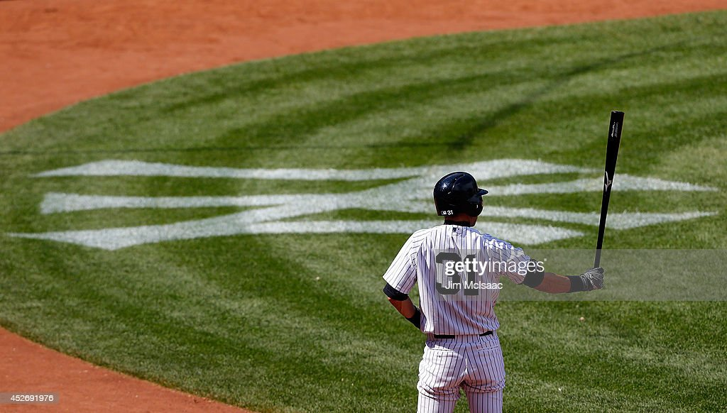 Ichiro Suzuki #31 of the New York Yankees waits to bat in the eighth inning against the Texas Rangers at Yankee Stadium on July 24, 2014 in the Bronx borough of New York City. The Yankees defeated the Rangers 4-2.