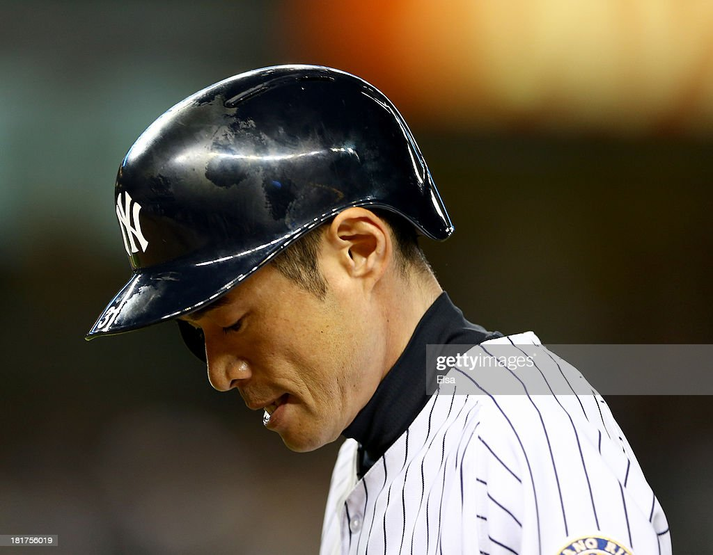 Ichiro Suzuki #31 of the New York Yankees walks back to the dugout after he hit a pop fly for the out in the first inning against the Tampa Bay Rays on September 24, 2013 at Yankee Stadium in the Bronx borough of New York City.
