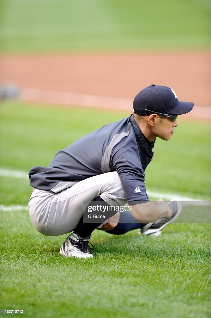 <a gi-track='captionPersonalityLinkClicked' href=/galleries/search?phrase=Ichiro+Suzuki&family=editorial&specificpeople=201556 ng-click='$event.stopPropagation()'>Ichiro Suzuki</a> #31 of the New York Yankees warms up before the game against the Baltimore Orioles at Oriole Park at Camden Yards on September 9, 2013 in Baltimore, Maryland.