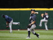 Ichiro Suzuki of the New York Yankees warms up during batting practice after being traded to the Yankees from the Seattle Mariners at Safeco Field on...