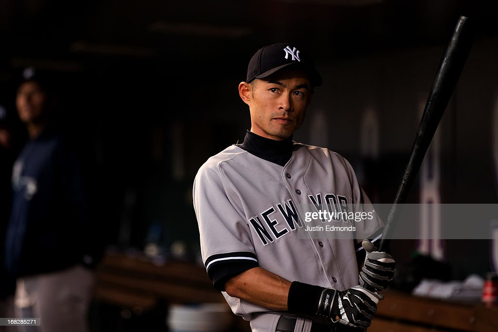 Ichiro Suzuki #31 of the New York Yankees warms up in the dugout before a game against the Colorado Rockies at Coors Field on May 7, 2013 in Denver, Colorado.
