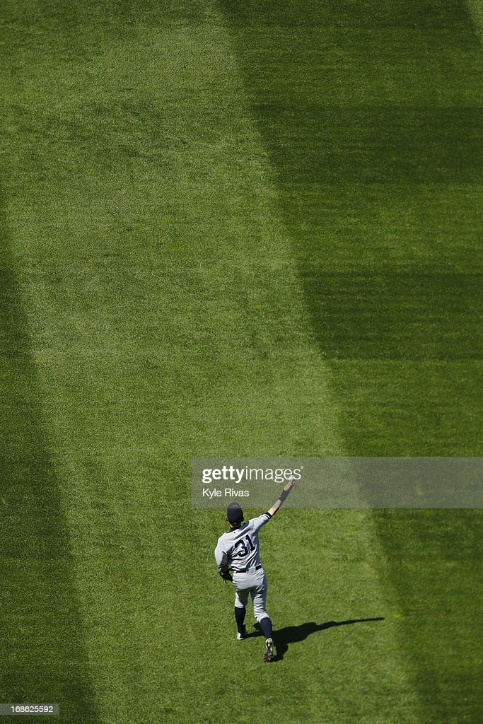 <a gi-track='captionPersonalityLinkClicked' href=/galleries/search?phrase=Ichiro+Suzuki&family=editorial&specificpeople=201556 ng-click='$event.stopPropagation()'>Ichiro Suzuki</a> #31 of the New York Yankees warms up in the seventh inning in the game against the Kansas City Royals on May 12, 2013 at Kauffman Stadium in Kansas City, Missouri.