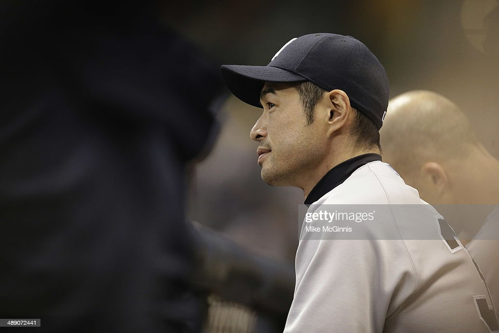 <a gi-track='captionPersonalityLinkClicked' href=/galleries/search?phrase=Ichiro+Suzuki&family=editorial&specificpeople=201556 ng-click='$event.stopPropagation()'>Ichiro Suzuki</a> #31 of the New York Yankees watches the interleague game from the dugout during the fourth inning against the Milwaukee Brewers at Miller Park on May 09, 2014 in Milwaukee, Wisconsin.
