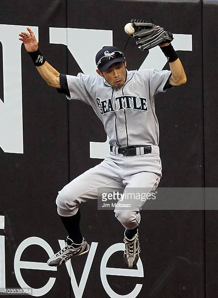 Ichiro Suzuki of the Seattle Mariners can not keep the ball in his glove on a ball hit for a double by Nick Swisher of the New York Yankees during...
