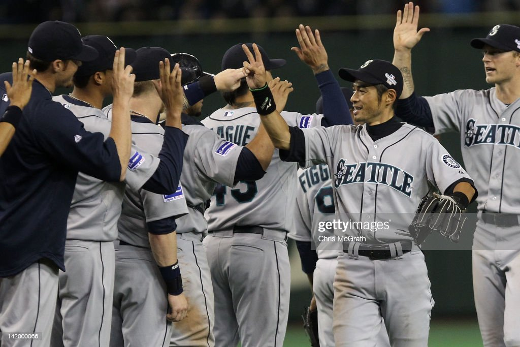 <a gi-track='captionPersonalityLinkClicked' href=/galleries/search?phrase=Ichiro+Suzuki&family=editorial&specificpeople=201556 ng-click='$event.stopPropagation()'>Ichiro Suzuki</a> #51 of the Seattle Mariners celebrates with team mates after defeating the Oakland Athletics 3-1 during the MLB Opening Series game between the Seattle Mariners and Oakland Athletics at Tokyo Dome on March 28, 2012 in Tokyo, Japan.