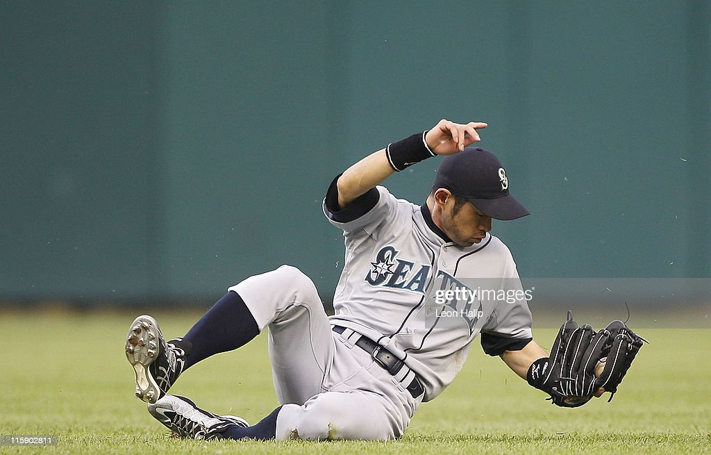 Ichiro Suzuki #51 of the Seattle Mariners dives and makes the catch on the line drive off the bat of Austin Jackson #14 of the Detroit Tigers in the fifth inning of the game at Comerica Park on June 11, 2011 in Detroit, Michigan. The Tigers defeated the Mariners 8-1.