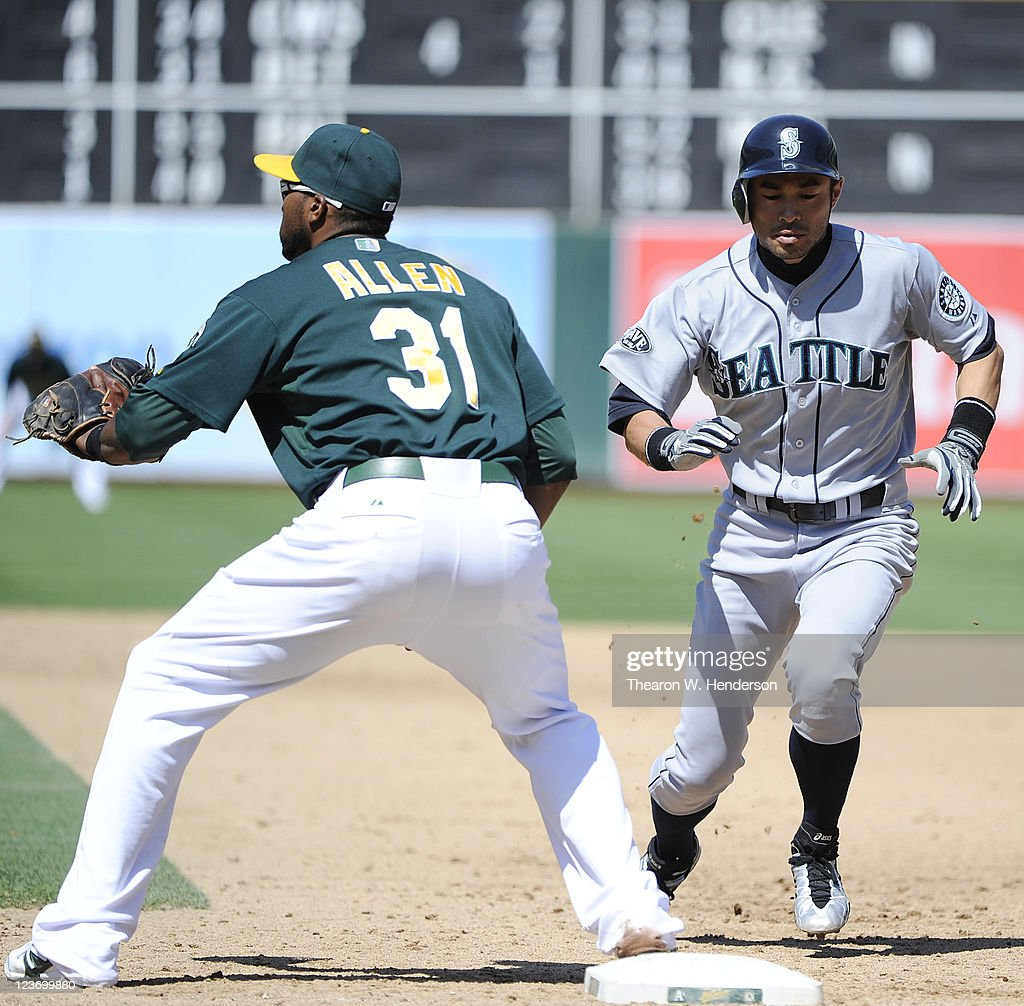 <a gi-track='captionPersonalityLinkClicked' href=/galleries/search?phrase=Ichiro+Suzuki&family=editorial&specificpeople=201556 ng-click='$event.stopPropagation()'>Ichiro Suzuki</a> #51 of the Seattle Mariners gets back to first before <a gi-track='captionPersonalityLinkClicked' href=/galleries/search?phrase=Brandon+Allen+-+Baseball+Player&family=editorial&specificpeople=2238262 ng-click='$event.stopPropagation()'>Brandon Allen</a> #31 of the Oakland Athletics can receive the throw over from the pitcher during an MLB baseball game at O.co Coliseum on September 3, 2011 in Oakland, California. The Athletics won the game 3-0.