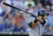 Ichiro Suzuki of the Seattle Mariners hits a single against the Kansas City Royals in the first inning at Kauffman Stadium on July 16 2012 in Kansas...