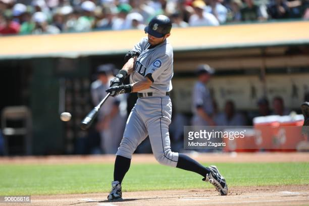 OAKLAND CA SEPTEMBER 6 Ichiro Suzuki of the Seattle Mariners hits his 2000th career hit during the game against the Oakland Athletics at the Oakland...