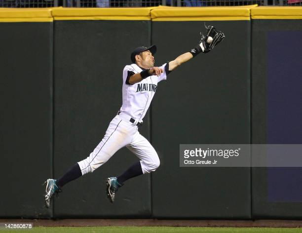 Ichiro Suzuki of the Seattle Mariners makes a leaping catch on a ball hit by Coco Crisp of the Oakland Athletics in the home opener at Safeco Field...