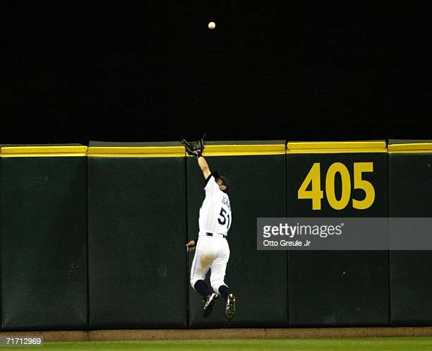Ichiro Suzuki of the Seattle Mariners makes a leaping overtheshoulder catch against the New York Yankees August 24 2006 at Safeco Field in Seattle...