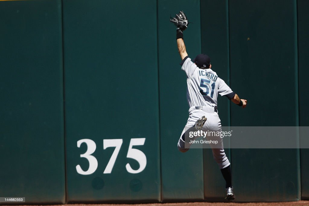 <a gi-track='captionPersonalityLinkClicked' href=/galleries/search?phrase=Ichiro+Suzuki&family=editorial&specificpeople=201556 ng-click='$event.stopPropagation()'>Ichiro Suzuki</a> #51 of the Seattle Mariners makes the catch on the warning track during the game against the Cleveland Indians at Progressive Field on May 17, 2012 in Cleveland, Ohio.