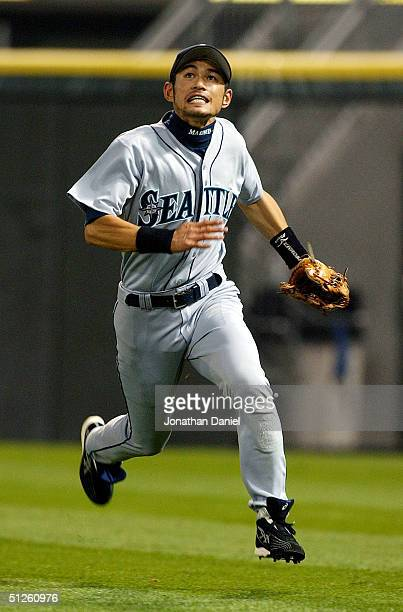 Ichiro Suzuki of the Seattle Mariners runs in an attempt to catch a foul ball against the Chicago White Sox on September 3 2004 at US Cellular Field...