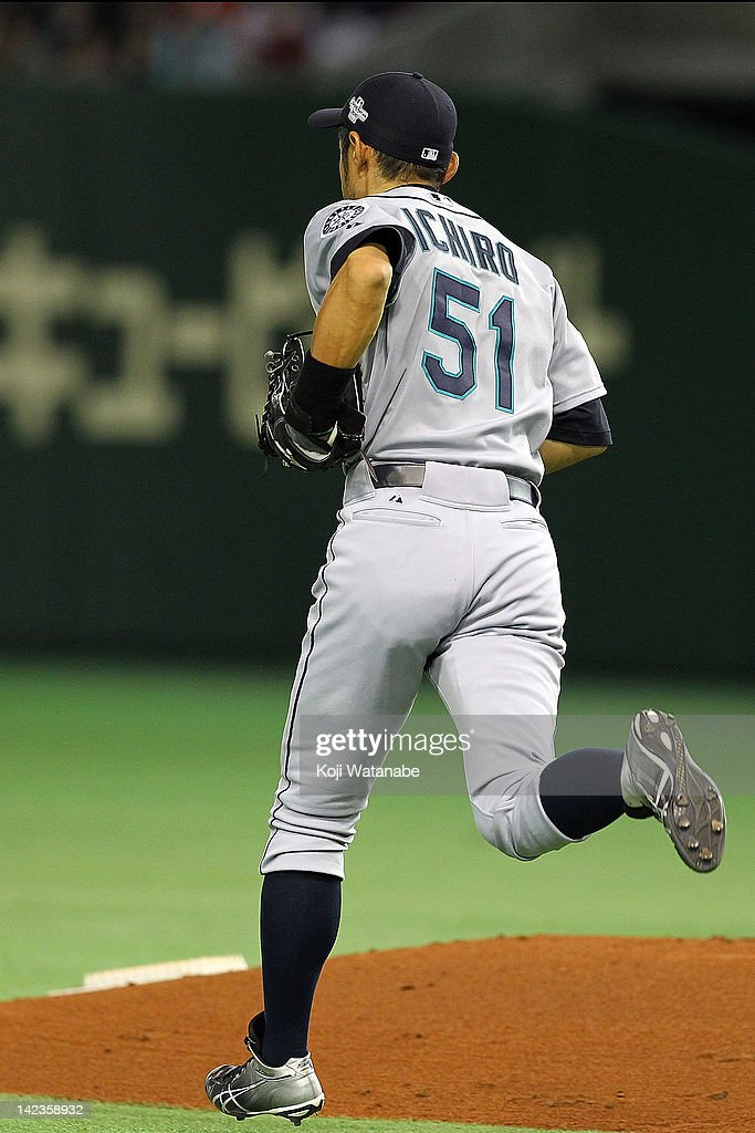Ichiro Suzuki of the Seattle Mariners runs to right field during the MLB Opening game between Seattle Mariners and Yomiuri Giants at Tokyo Dome on March 29, 2012 in Tokyo, Japan.