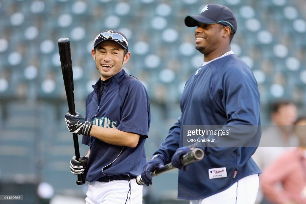 Ichiro Suzuki #51 of the Seattle Mariners smiles with Ken Griffey Jr. #24 during practice before the game against the New York Yankees on September 18, 2009 at Safeco Field in Seattle, Washington.