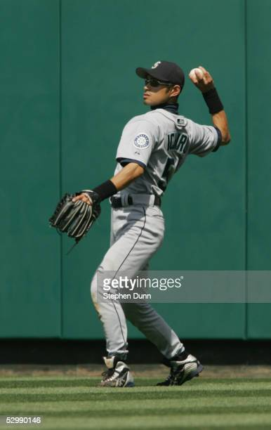 Ichiro Suzuki of the Seattle Mariners throws the ball against the Los Angeles Angels of Anaheim during the game at Angel Stadium on April 19 2005 in...