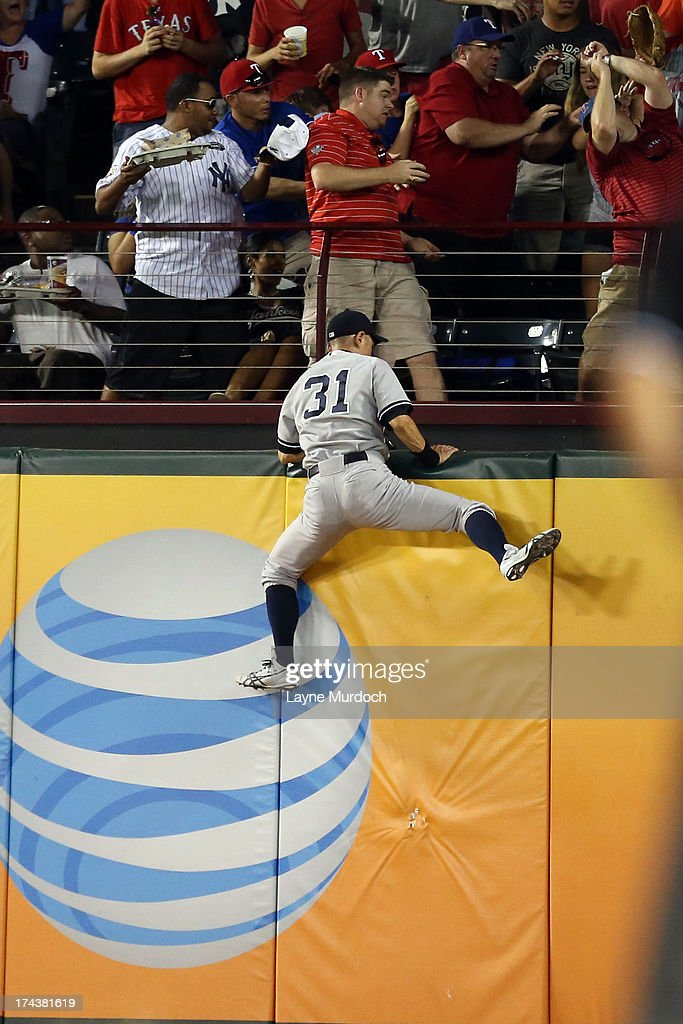 <a gi-track='captionPersonalityLinkClicked' href=/galleries/search?phrase=Ichiro+Suzuki&family=editorial&specificpeople=201556 ng-click='$event.stopPropagation()'>Ichiro Suzuki</a> #31, right fielder for the New York Yankees climbs the wall attempting to catch the home run of A.J. Pierzynski #12 of the Texas Rangers on July 24, 2013 at the Rangers Ballpark in Arlington in Arlington, Texas.