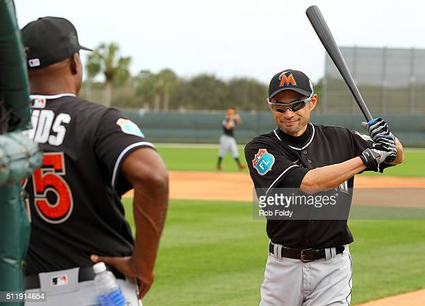 Ichiro Suzuki talks with new Marlins hitting coach Barry Bonds during a Miami Marlins workout on February 23 2016 in Jupiter Florida