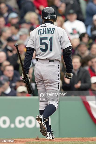 Ichiro Suzuki#51 of the Seattle Mariners walks off the field after striking out against the Boston Red Sox during the home opener game on April 10...