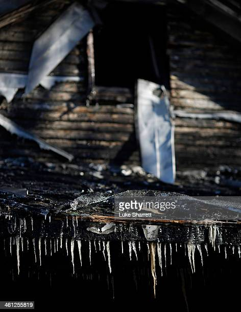 Icicles formed by water from fire department hoses hang from the charred remnants of 58yearold Gerry Jennette's home in bitter cold belowzero...