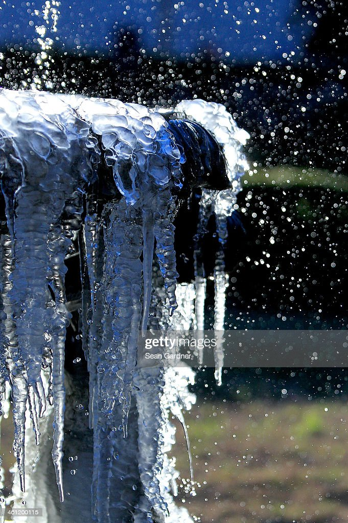 Icicles hang from a fountain along Canal Street as temperatures in the area plummeted below freezing on January 7 2014 in New Orleans Louisiana Highs...