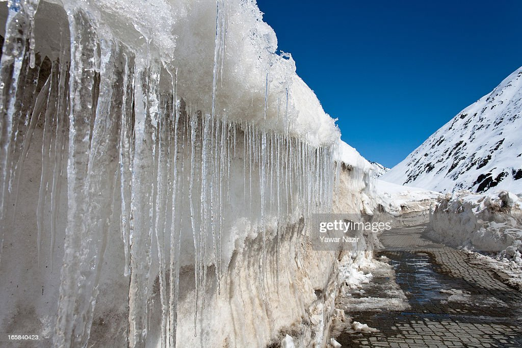 Icicles hang from snow on Srinagar-Leh highway after it was reopen by authorities on April 06, 2013 in Zojila, 108 km (67 miles) east of Srinagar, the summer capital of Indian administered Kashmir, India. The 443 km (275 miles) long Srinagar-Leh highway was opened for vehicular traffic by Indian Border Roads Organisation after remaining snowbound at Zojila Pass for the past six months. The pass connects Kashmir with Ladakh region a famous tourist destination among foreign tourists for its monasteries, landscapes and mountains.