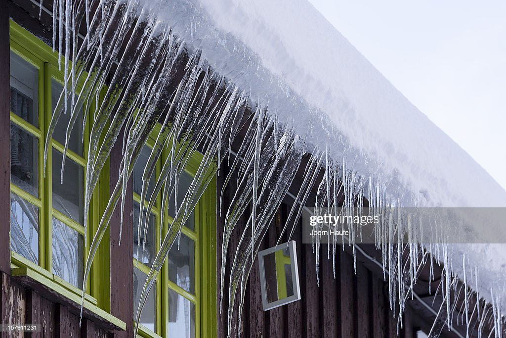 Icicles hang in front of a window on December 7, 2012 in Hermsdorf, Germany. A low pressure system dumped snow on the south and east of the country before heading west.