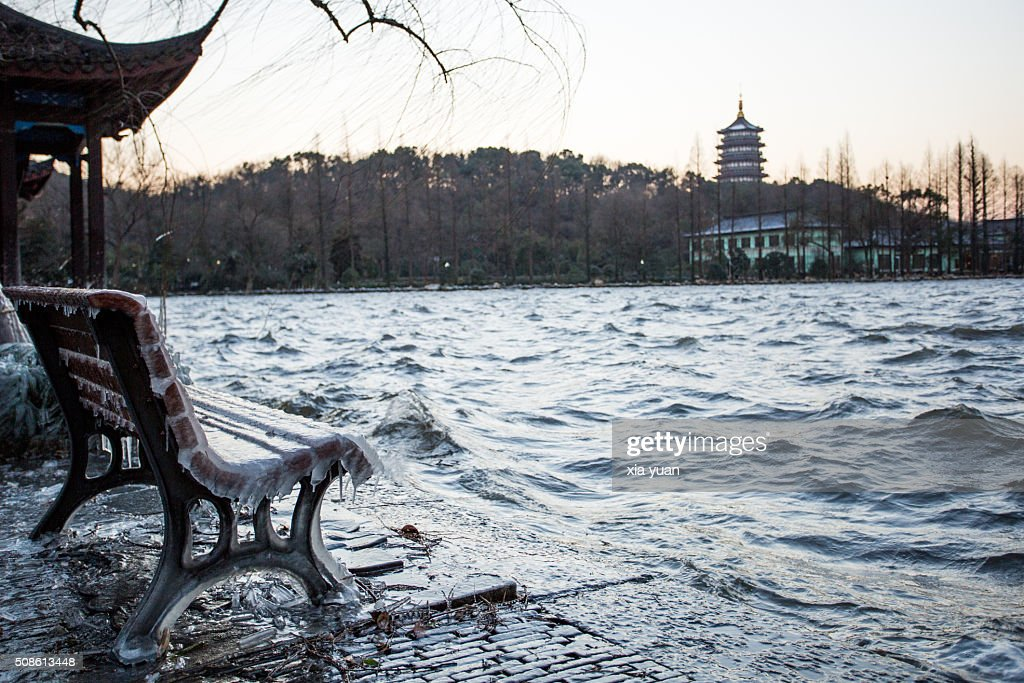 Icicles on bench against the Leifeng Pagoda by the West Lake,Hangzhou,Zhejiang,China : Stock Photo