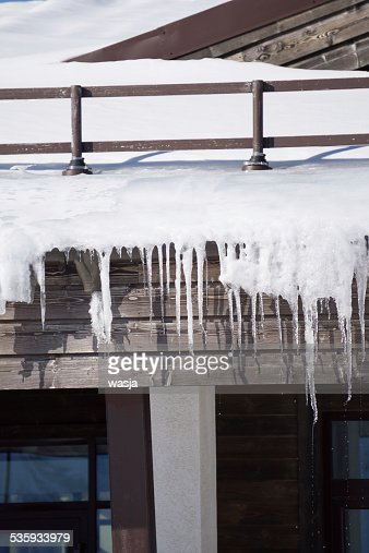 Icicles on the roof of a house : Stock Photo