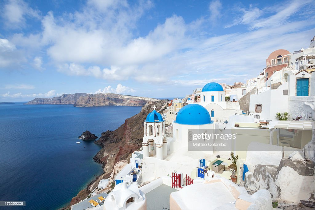 Iconic blue domed churches in Oia Santorini Greece