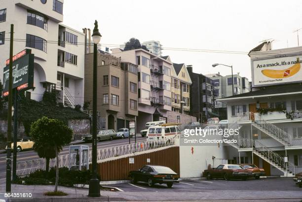 Iconic hilly street in San Francisco with sign advertising bananas on sale at Western supermarket chain Lunardis San Francisco California 1978