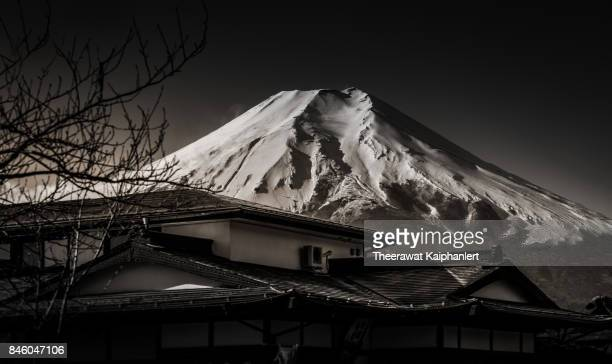 Iconic Mount Fuji of Japan and traditional house in black and white